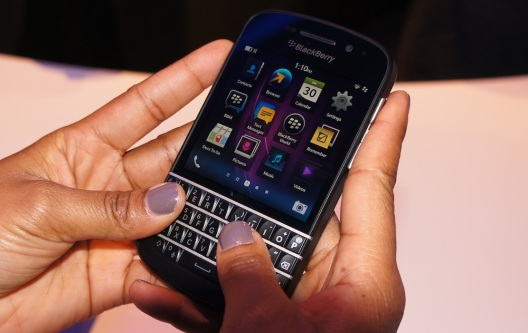 Blackberry Q10, touchscreen phone with physical keypad.