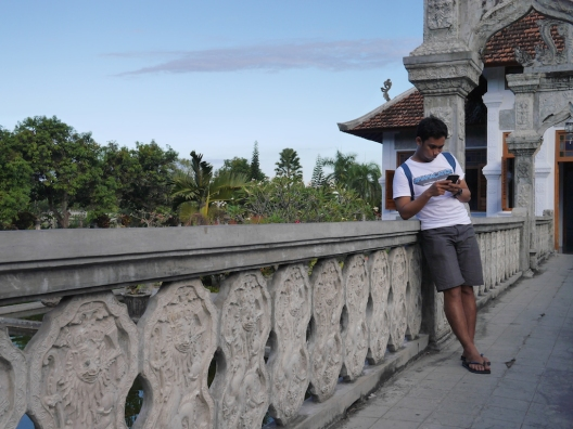 Writing down the journal, --taken at Taman Ujung, Karangasem, Bali.