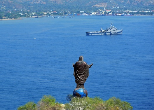 The statue of Cristo Rei (Christ the King) stands over the Dili harbor